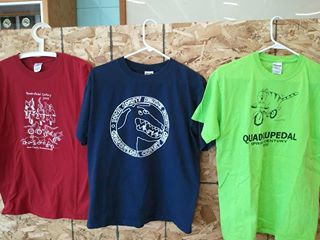 The red, blue, and green t-shirts