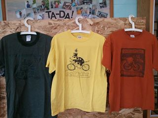 The heather green, yellow, and orange t-shirts